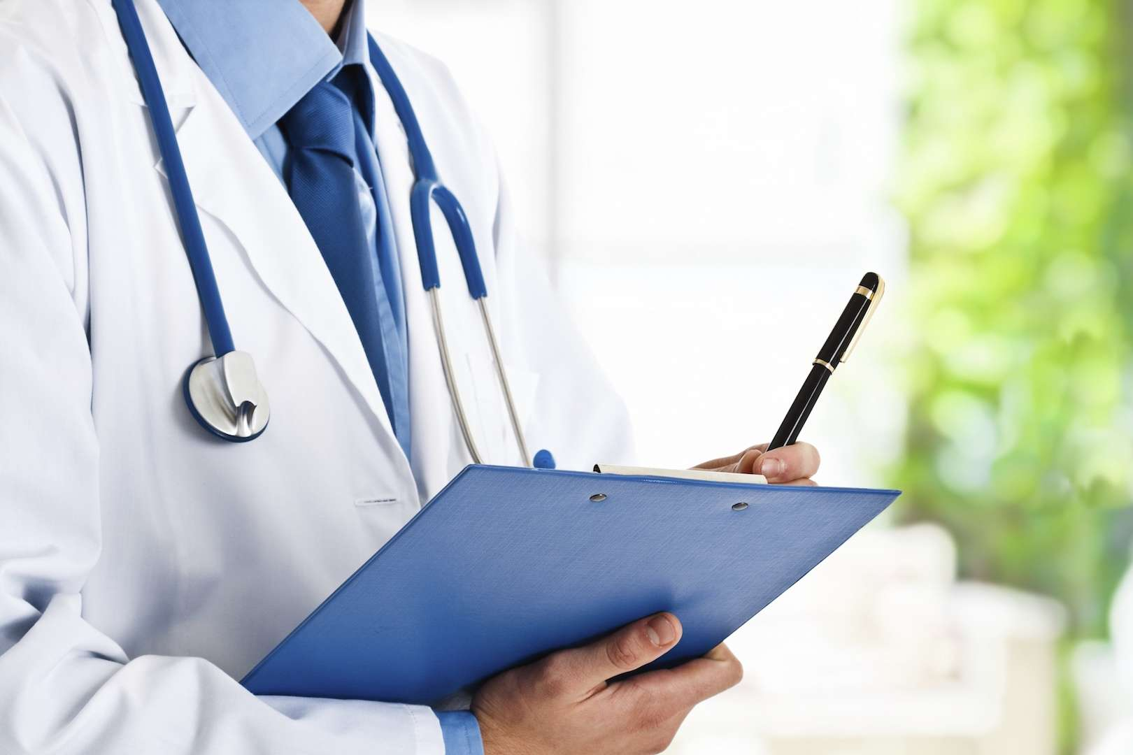 Image of Doctor holding notepad